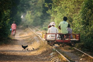 """A homemade train or """"Norry"""" made of bamboo and powered by a 6 horsepower gasoline engine travels along the Bamboo Train line, O Dambong, Battambang, Cambodia"""